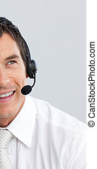 Portrait of a businessman with a headset on