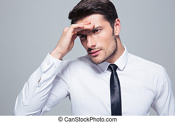 Portrait of a businessman with headache