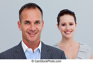 Portrait of a businessman with his female colleague
