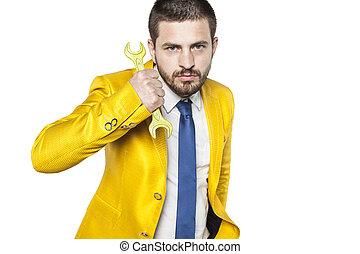 Portrait of a businessman with yellow key