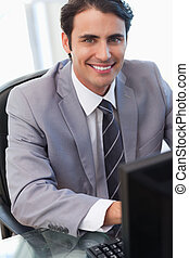 Portrait of a businessman working with a computer