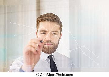 Portrait of a businessman working with digital virtual screen