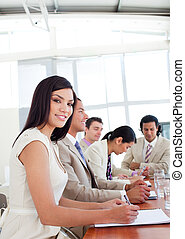 Portrait of a businesswoman and her team during a presentation
