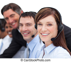 Portrait of a businesswoman and her team working in a call center in a company