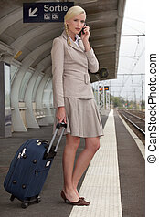 portrait of a businesswoman at train station