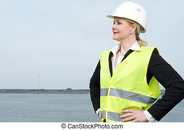 Portrait of a businesswoman in hardhat standing outdoors