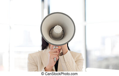 Portrait of a businesswoman shouting through megaphone
