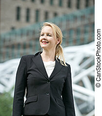 Portrait of a businesswoman smiling outdoors