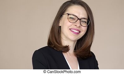 Portrait of a businesswoman with glasses smiling and happy
