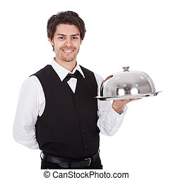 Portrait of a butler with bow tie and tray