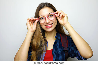 Portrait of a casual student woman in glasses looking at camera isolated on a white background