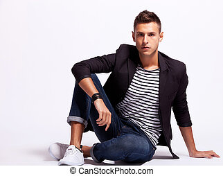 young fashion man sitting relaxed
