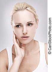 portrait of a caucasian blonde woman with toothache on grey ...