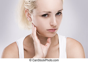 portrait of a caucasian blonde woman with toothache