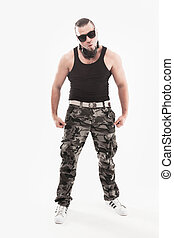 portrait of a charismatic disc jockey rapper in sunglasses with