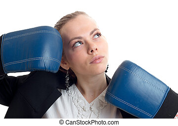 Portrait of a charming blonde that looks up and keeps hands near the person in blue boxing gloves