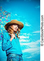 blue sky - Portrait of a charming girl in elegant hat...