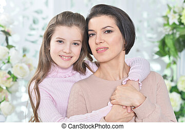 Portrait of a charming girl with mom