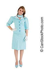 Portrait of a charming stewardess dressed in blue uniform