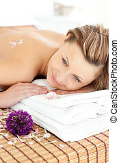 Portrait of a charming woman lying on a massage table