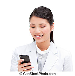 Portrait of a cheerful businesswoman looking at his phone