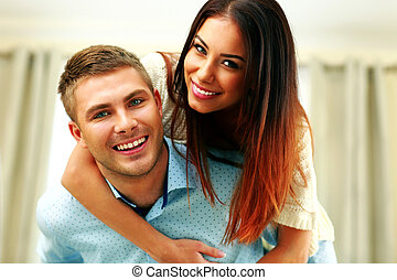 Portrait of a cheerful couple hugging