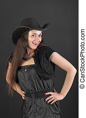 cheerful girl in a black hat