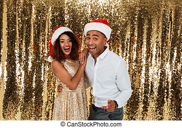 Portrait of a cheerful happy afro american couple in red...