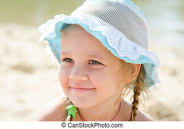 Portrait of a cheerful little girl on the beach in panama