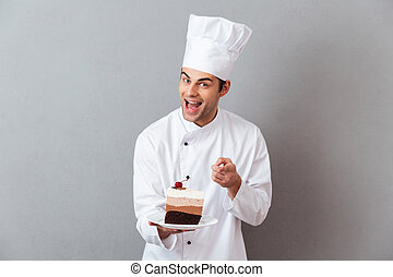 Portrait of a cheerful male chef dressed in uniform