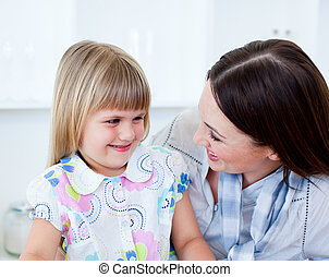Portrait of a cheerful mother and her cute little girl