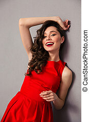 Portrait of a cheerful woman in red dress