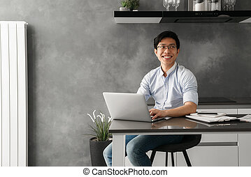 Portrait of a cheerful young asian man