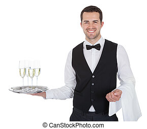 Portrait of a cheerful young butler