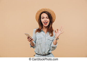 Portrait of a cheerful young girl in summer clothes