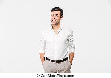 Portrait of a cheerful young man in white shirt