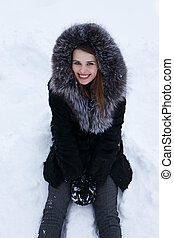 woman sitting on the snow