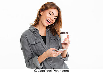 Portrait of a cheery young girl using mobile phone