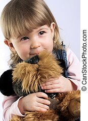 Portrait of a Child - A sweet 18 months old girl cuddles her...