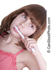 child brushing her teeth with a toothbrush