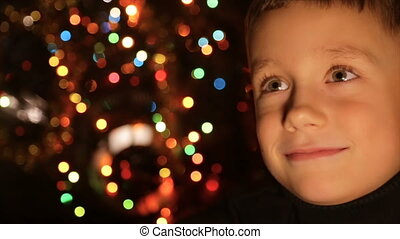 Portrait of a child in the background of Christmas lights