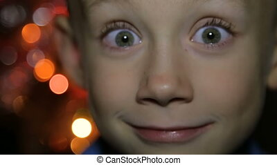 Portrait of a child in the background of Christmas lights -...