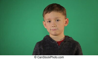 Portrait of a child on a green background - Portrait of a...