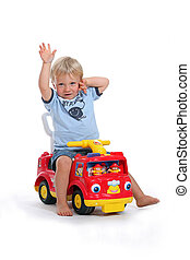 portrait of a child on toy car