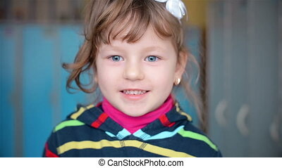 Portrait of a child who looks into the camera