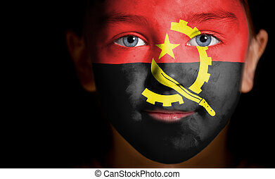 Portrait of a child with a painted Angolan flag