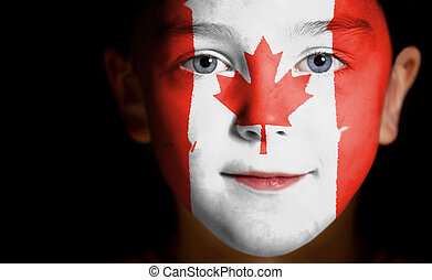 child with a painted Canadian flag