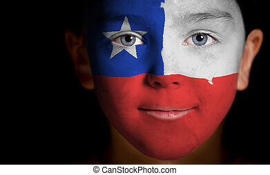 child with a painted Chile flag