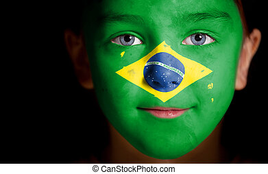 child with a painted flag