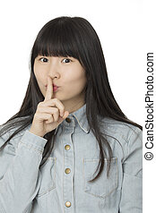 Portrait of a Beautiful Chinese American woman using hand gesture to say Be Quite displaying a bit of attitude isolated on a white background
